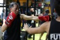 Parkinson's patient Jimmy Wong learning Muay Thai at the Fu Tak Gymnasium in Mong Kok, part of a programme designed specifically for Parkinson's sufferers. Photo: Xiaomei Chen