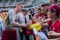 Liverpool FC Legends player Daniel Agger signs autographs for fans at Hong Kong Stadium on Saturday. Photo: Marcio Machado/Liverpool FC