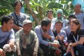 Rosanna Tuason-Fores, CEO and president (extreme right), sits for a chat with farmers.