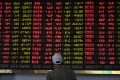 An investor monitors stock price movements at a securities company in Shanghai on May 8, 2019. Photo: Agence-France Presse