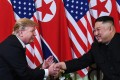 """US President Donald Trump and North Korean leader Kim Jong-un shake hands following a meeting in Hanoi, Vietnam, on February 27, 2019. Since then, North Korea has undertaken missile tests and Trump has voiced confidence that Kim will not """"break his promise"""". Photo: AFP"""