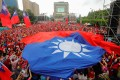 Supporters of Kaohsiung mayor Han Kuo-yu, from the Kuomintang, hold Taiwanese flags during a campaign event in Taipei on June 1. Photo: AFP