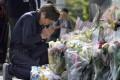 A man prays at the site of a mass stabbing in Kawasaki, near Tokyo, on June 4. Photo: Kyodo