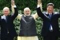 Vladimir Putin, Narendra Modi and Xi Jinping at a summit in India in 2016. Photo: AP