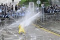 Police officers use a water canon on a lone protester near the government headquarters in Hong Kong on June 12, 2019. Photo: AFP