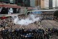 Police use tear gas against the anti-extradition protesters on Harcourt Road in Admiralty on Wednesday. Photo: May Tse