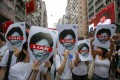Protesters hold pictures of Hong Kong Chief Executive Carrie Lam as they march against the extradition bill from Causeway Bay to Admiralty on June 9. Photo: AP