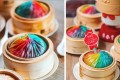 The mega-sized rainbow version comes served in a bamboo basket at Din Tai Fung Australia. Photo: Instagram / Din Tai Fung Australia