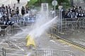 Police officers use water cannon on a lone protester near the government headquarters in Hong Kong on June 12. Photo: AFP