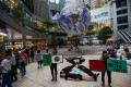 """Members of Extinction Rebellion Hong Kong perform a silent """"die-in"""" to demand quick action on climate change, at a shopping centre in Tsuen Wan on May 4. Photo: Handout"""