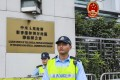 Two police officers stand guard outside The Liaison Office of the Central People's Government in the HKSAR in Sai Wan. Photo: May Tse