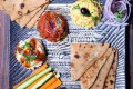 Cardamon Street's mezze platter is served with pita bread flavoured with spices like rosemary.