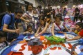 Children play at the Hong Kong Toy Festival in Wan Chai on June 16. The spirited nature of Hongkongers is essential to the city's economic survival. Photo: Jonathan Wong