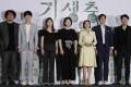 South Korean director Bong Joon-ho, left, with cast members of Parasite. Photo: AP