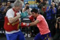 Trainer Freddie Roach and Manny Pacquiao are back together as a team for the fight against Keith Thurman on July 20 in Las Vegas. Photo: AP