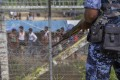 Myanmar border guard police patrol the fence in the 'no man's land' zone between Myanmar and Bangladesh. Photo: AFP