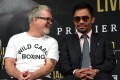 Trainer Freddie Roach laughs with Manny Pacquiao during the press conference for their fight against Keith Thurman at The Beverly Hills Hotel. Photo: AFP