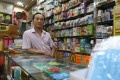 Alan Cheung, owner of Sands Medicine Shop, is costing the costs of the protests. Photo: Nora Tam