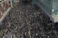 Protesters outside police headquarters in Wan Chai on Friday. Photos: Martin Chan