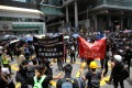 Protesters besiege Hong Kong police headquarters in Wan Chai for 15 hours on Friday. Photo: Winson Wong