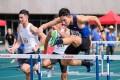 Hurdler Mui Ching-yeung on his way to second place at Tseung Kwan O Sports Ground. Photo: HKAAA