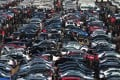 People select automobiles at a second-hand market in Shenyang, Liaoning province December 10, 2011. Photo: Reuters