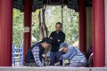 Men play chess in a Chinese-style pavilion in King George V Memorial Park, Kowloon. It is one of two parks named after the British monarch in Hong Kong. Photo: Christopher DeWolf