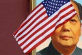 A US flag flutters in front of a portrait of the late Chinese Chairman Mao Zedong during a visit by US President Donald Trump to Beijing, China, in 2017. Photo: Reuters