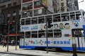 MetLife's advertising on a Hong Kong tram featuring Snoopy and his friends on Hennessy Road in Wan Chai on June 22, 2017.Photo: SCMP