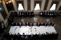 Negotiating teams meeting at the White House in Washington ahead of trade talks in February. Photo: Reuters
