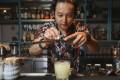 Eshka Gurung mixes a caipirinha at Uma Nota, in Central, Hong Kong. Photo: Chen XIaomei