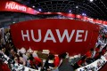 Workers sit a the Huawei stand at the Mobile Expo in Bangkok, Thailand May 31, 2019. Photo: Reuters