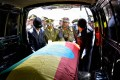 Members of the army carry one of the coffins covered with the Ethiopian national flag. Photo: AFP