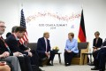 US President Donald Trump with Germany's Chancellor Angela Merkel at the G20 summit in Osaka on Friday. Photo: AFP