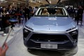 FVisitors check out a NIO ES8 displayed during a media preview at the Auto China 2018 motor show in Beijing, China April 25, 2018. Photo: Reuters