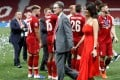 Liverpool owner John W. Henry and his wife Linda Pizzuti on the Wanda Metropolitano pitch after the Champions League triumph in Madrid. Photo: Reuters