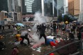 Anti-extradition demonstrators throw projectiles at police officers on Harcourt Road in Admiralty on June 12. Photo: Sam Tsang