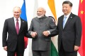 (From left) Russian President Vladimir Putin, Indian Prime Minister Narendra Modi and Chinese leader Xi Jinping meet on the sidelines of the G20 summit in Osaka, Japan, on Friday. Photo: EPA-EFE