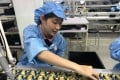 A worker in the adapter production line in a plant inside Vietnam-China Economic and Trade Cooperation Park. Photo: Cissy Zhou