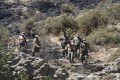 Military personnel walk on a slope near where the missile struck in northern Cyprus. Photo: Reuters