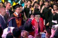 Li Ka-shing waves to the crowd at the Shantou University graduation ceremony in June 2018, as his son Richard Li Tzar-kai follows close behind. The Hong Kong tycoon has given more than HK$10 billion to the university he co-founded in his hometown. Photo: Thomas Yau