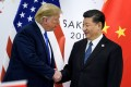 China's President Xi Jinping (right) shakes hands with US President Donald Trump before a bilateral meeting on the sidelines of the G20 Summit in Osaka on June 29, 2019. Photo: AFP
