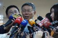 Taipei Mayor Ko Wen-je holds a brief news conference ahead of his three-day visit to the mainland on Wednesday, where he will lead a delegation to the annual Taipei-Shanghai City Forum. Photo: Central News Agency