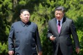 North Korean leader Kim Jong-un (left) and Chinese President Xi Jinping at their second meeting in six weeks in the Chinese city of Dalian. Photo: AFP