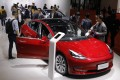 Visitors inspect a Tesla Model 3 during the media day of the Auto Shanghai 2019 motor show in Shanghai on April 16. Photo: EPA-EFE