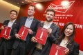 (From left) Frank Renrong Wang, executive director of Budweiser Brewing Company APAC, CEO Jan Craps, CFO Gui Castellam and head of investor relations Heidi Li, at the company's press conference to announce the IPO. Photo: K. Y. Cheng