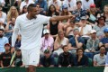 Nick Kyrgios has some fun during his first round match against Australia's Jordan Thompson at Wimbledon. Photo: Reuters