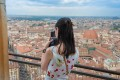 A tourist takes a photo from the observation platform on the dome of Florence Cathedral in Italy. Photo: Handout