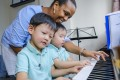 Charliah Best (in blue shirt), director of Best Music Academy in Hong Kong, teaching music to brothers Zachary, 4, (left) and Cameron, 3, in Causeway Bay. She says the positive impact music has on the kids' emotional, social and physical well-being is evident. Photo: Tory Ho
