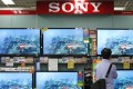 A man looks at Sony TV sets in Tokyo. File photo: Reuters